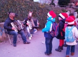 Engaged children joining in the Christmas market fun!